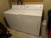 white front-load clothes dryer and washing machine Calgary, T3Z 0A8