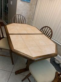 Kitchen table with hide away leaf to extend table and four chairs Ave Maria, 34142