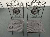 two brown metal armless chairs