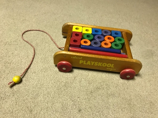 brown, green, and blue Playskool wagon toy