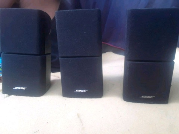 three black Bose multimedia speakers