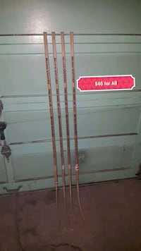 4 junior wooden hockey sticks Edmonton, T5Z 2L2