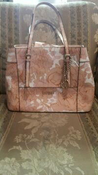 Guess pink and white purse.  Winnipeg, R3G 1R1