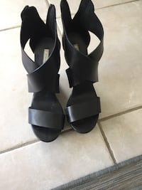 pair of black open-toe ankle strap heeled sandals