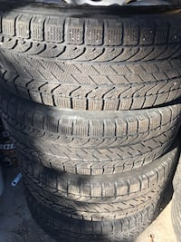 Winter tires on rims 215/70 r16 Pointe-Claire, H9R