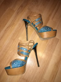 Price is FIRM.   BRAND NEW NEVER WORN- size 8.5 Stunning stiletto Sandals Beige and Turquoise in color with gold color heel and sparkling addition added to make them even more beautiful!  Edmonton, T5A