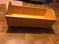 """Large solid wooden doll cradle. Measures 24""""L, 12""""W, & 12""""H. Beautiful!  Bellport, 11713"""