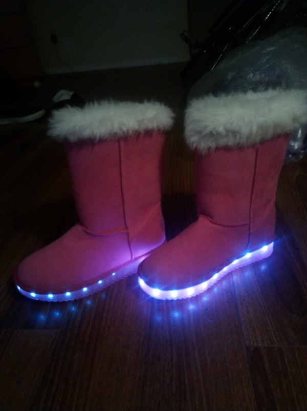 pair of red-and-white LED snow boots