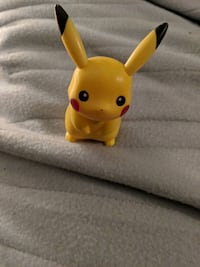 yellow and green plastic toy