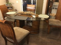 Gorgeous solid wood table with glass topper! 4 solid wood chairs and stunning curio with adjustable glass shelves. Airdrie, T4A 0L7