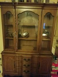 brown wooden framed glass display cabinet Piscataway Township, 08854