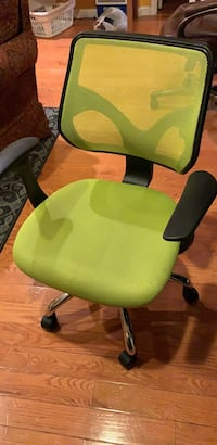 Green and black rolling office chair