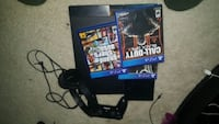 black Sony PS4 console with controller and game cases Silver Spring, 20907