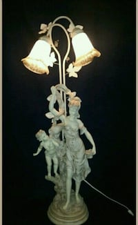 Signed stone finish Victorian Cherub lamp