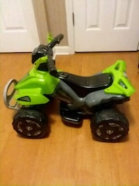 toddler's black and green ride-on ATV toy Wallace