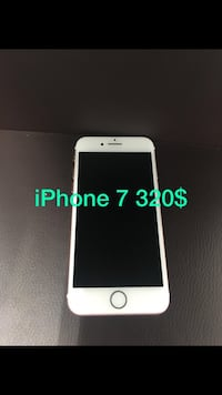 white iPhone 5 with text overlay 紐約, 11222