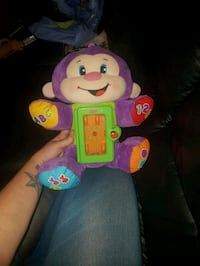 purple and beige Fisher-Price monkey plush toy