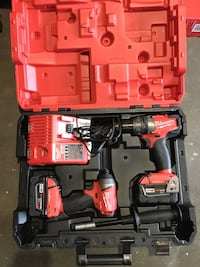 red and black Milwaukee cordless power drill kit