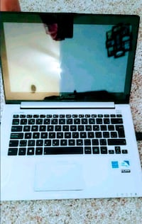 Asus notebook; touch screen  1971 km
