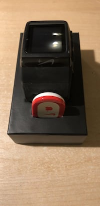 black Nike+ smartwatch with black sportsband and box