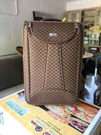 brown and black houndstooth luggage Los Angeles, 90026