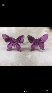 Butterfly drape or curtain clips for window