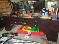 Brown wooden table with assorted toys Des Plaines, 60016