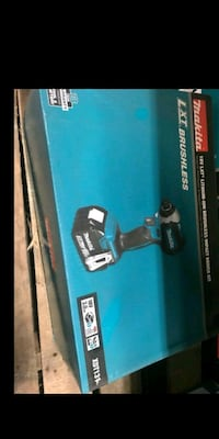 blue and black Makita angle grinder box 2216 mi