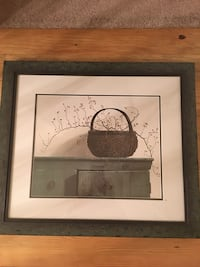 wicker basket on table painting with brown frame