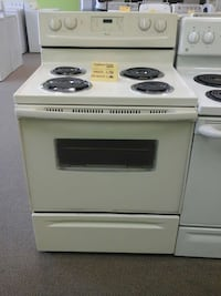 beige and black Whirlpool electric coil range oven Clayton, 27520