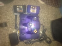 N64 atomic purple console complete with cords matching controller and 7 games  Arcade, 95821