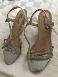 Pair of gray leather open-toe ankle strap heels
