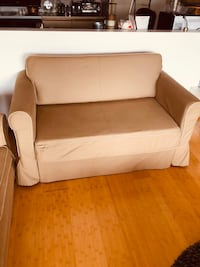 brown leather sofa chair with throw pillow Quincy, 02169