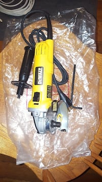 yellow and black DeWalt corded angle grinder 46 km