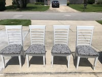 four white wooden padded chairs Jacksonville, 32244