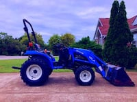 New Holland TC24DA Loader - Dearborn