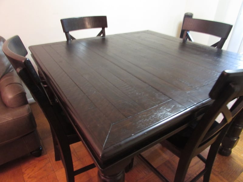 Ashley solid wood dining table with 4 chairs and a bench 55e774fa-8126-4030-917d-9b43bd47ad5e