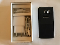 Black Samsung S6 edge 32 GB smartphone with charger adapter in box