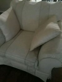 An off white fabric single seater couch Calgary, T2H 2J8