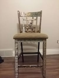 brown wooden framed gray padded chair St. Catharines, L2M 7E6