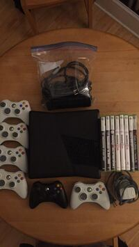 Xbox 360 with 6 controllers, 8 games, and battery charging station Philadelphia, 19130
