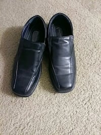 pair of black leather loafers 45 km