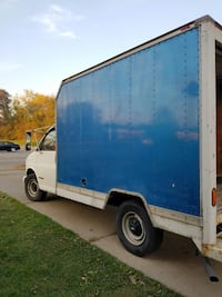 white and blue box truck