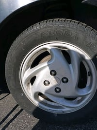 2000ford escort wheels and tires, new, including the car
