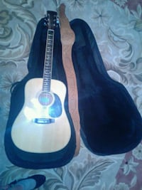blue and white acoustic guitar with case Calgary, T3K