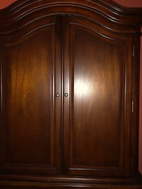 Attractive dark wood 2 door TV armoire with 3 drawers Ashburn