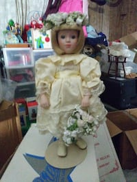 yellow dressed porcelain doll