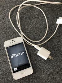 iPhone 4 with charger  Courtice, L1E 2X3