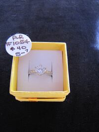 #1054 YELLOW GOLD ACCENT RING WITH CLEAR CENTER