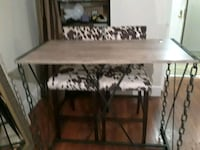 rectangular brown wooden table with chairs New York, 10023